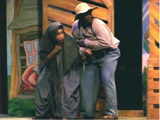 Two people performing in a play