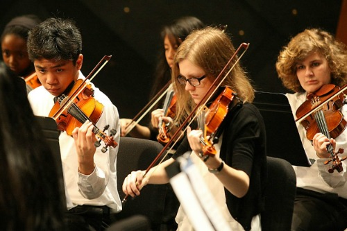 Photo of students playing their instruments